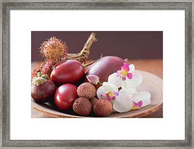 Assorted Exotic Fruits In A Dish With Orchids Framed Print