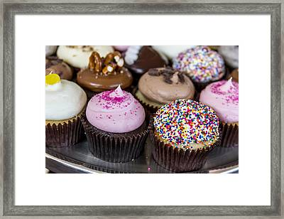 Assorted Flavors Of Cupcake On Display Framed Print