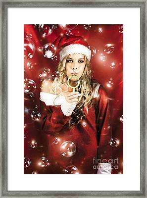 Attractive Christmas Woman Blowing Magic Bubbles Framed Print by Jorgo Photography - Wall Art Gallery