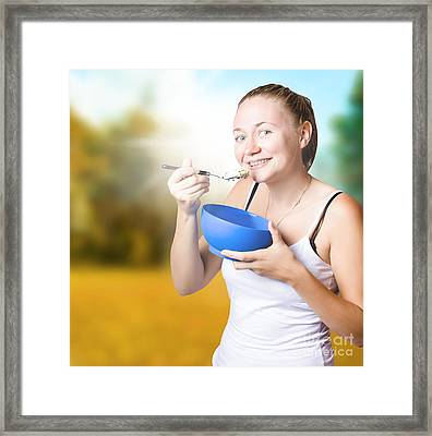 Attractive Young Blond Woman Eating Oatmeal Framed Print