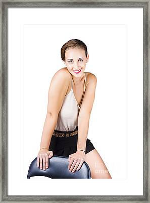 Attractive Young Woman Posing On Chair Framed Print