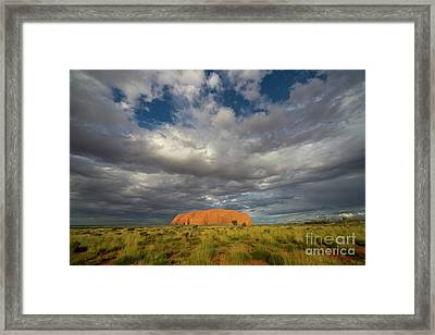 Ayers Rock And Storm Clouds Australia Framed Print by Yva Momatiuk John Eastcott