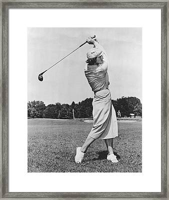 Babe Didrikson Golfing Framed Print by Underwood Archives