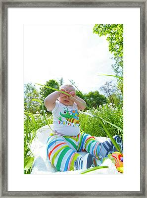 Baby Boy In A Park Framed Print