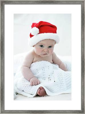 Baby Boy Wearing Santa Hat Framed Print