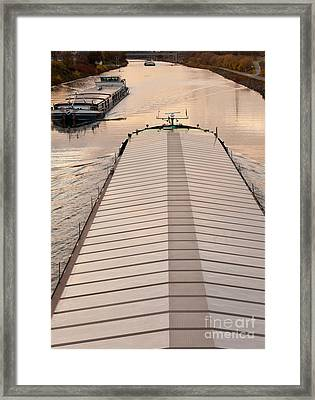 Barges Plying Waterway Channel In Industrial Area Framed Print by Stephan Pietzko