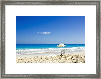 Framed Print featuring the photograph Beach Chair And Umbrella On Idyllic Tropical Sand by Mohamed Elkhamisy