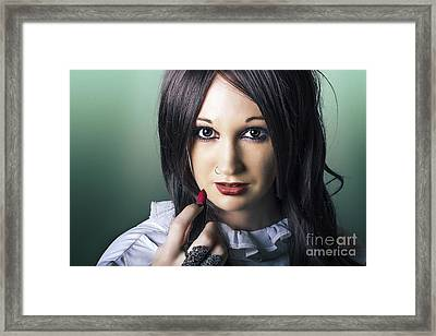 Beautiful Alternative Woman Applying Lipstick Framed Print by Jorgo Photography - Wall Art Gallery