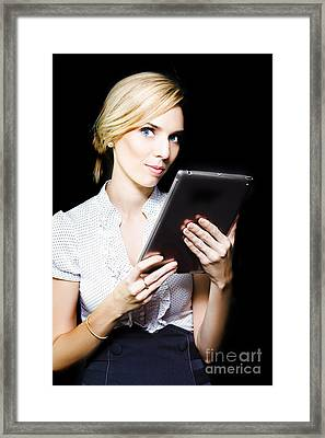 Beautiful Blonde Using A Touch Screen Tablet Framed Print