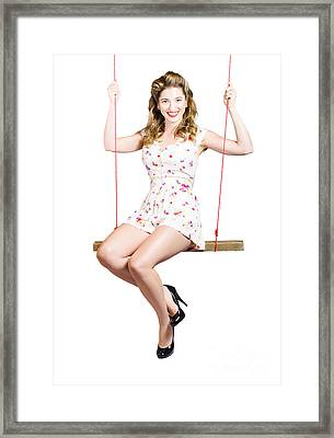 Beautiful Fifties Pin Up Girl Smiling On Swing Framed Print