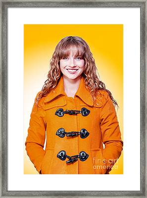 Beautiful Woman In Orange Winter Coat Framed Print