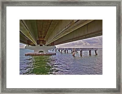 Framed Print featuring the photograph Beneath Sanibel Bridge by Timothy Lowry