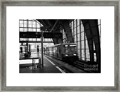 Berlin S-bahn Train Speeds Past Platform At Alexanderplatz Main Train Station Germany Framed Print by Joe Fox