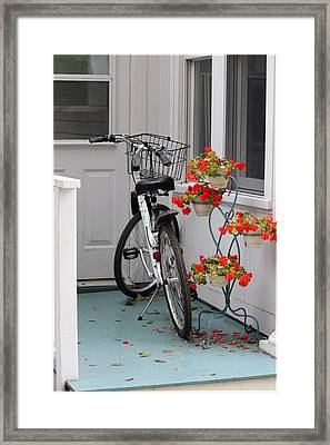 Bicycles And Geraniums Framed Print
