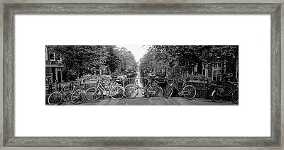 Bicycles On Bridge Over Canal Framed Print
