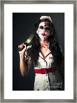 Bleeding Psychotic Medic Woman With Amputation Saw Framed Print by Jorgo Photography - Wall Art Gallery