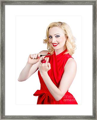 Blond Pinup Woman In Red Dress Making Manicure Framed Print by Jorgo Photography - Wall Art Gallery