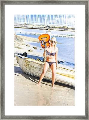 Blonde Female Traveling Entertainer At Beach Framed Print by Jorgo Photography - Wall Art Gallery