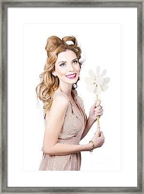 Blonde Girl Holding Windmill Fan. Natural Energy Framed Print