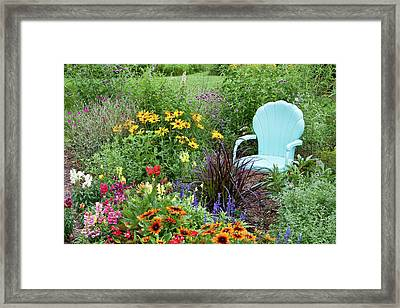 Blue Chair And Various Flowers Framed Print by Panoramic Images