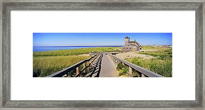 Boardwalk Leading Towards Old Harbor Framed Print by Panoramic Images