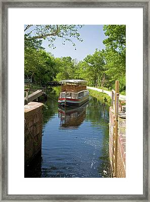 Boat Approaching An Open Canal Lock Framed Print