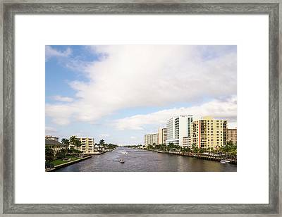 Boats And Modern Buildings Framed Print