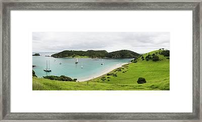 Boats Docked In Small Bay Framed Print