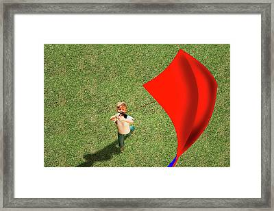 Boy Flying A Kite Framed Print by Carol & Mike Werner