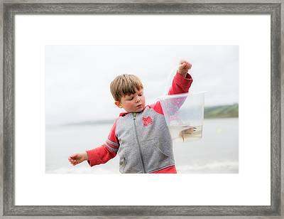 Boy Holding Crab Framed Print