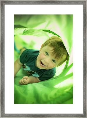 Boy In Green Tunnel Framed Print