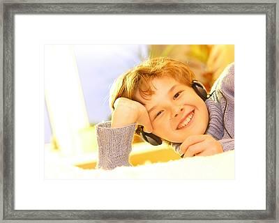 Boy Listen To Music Framed Print by Michal Bednarek