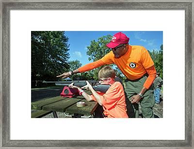 Boy Shooting A Bb Gun Framed Print