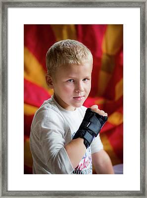 Boy With Brace On Broken Wrist Framed Print