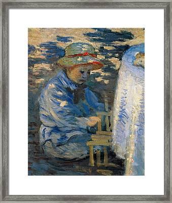 Breakfast In The Garden Framed Print by Claude Monet