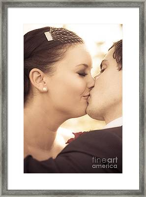Bride And Groom Kissing Framed Print