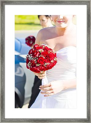 Bride Holding Red Rose Flower Bunch Framed Print by Jorgo Photography - Wall Art Gallery