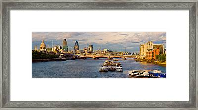 Bridge Across A River With A Cathedral Framed Print
