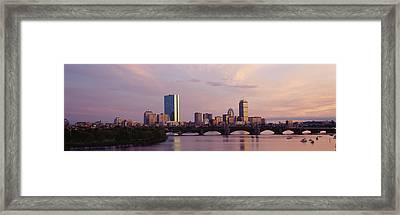 Bridge Across A River With City Framed Print by Panoramic Images