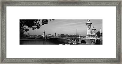 Bridge Across A River With The Eiffel Framed Print by Panoramic Images