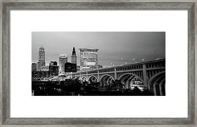 Bridge In A City Lit Up At Dusk Framed Print by Panoramic Images
