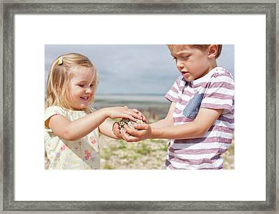 Brother And Sister Collecting Stones Framed Print by Ian Hooton