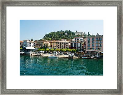 Buildings In A Town At The Waterfront Framed Print by Panoramic Images