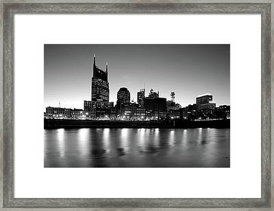 Buildings Lit Up At Dusk Framed Print