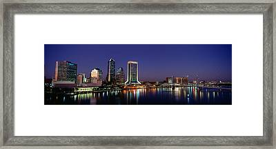 Buildings Lit Up At Night Framed Print by Panoramic Images