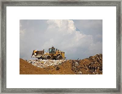 Bulldozer On A Landfill Site Framed Print