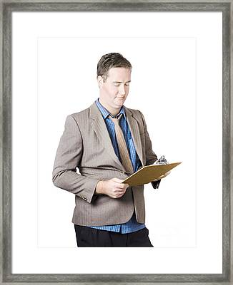 Business Man Holding Audit Clip Board Framed Print by Jorgo Photography - Wall Art Gallery