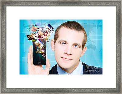 Business Man Steaming Media Apps On Smart Phone Framed Print by Jorgo Photography - Wall Art Gallery