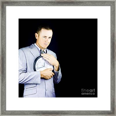 Business Person Hugging Clock Framed Print by Jorgo Photography - Wall Art Gallery