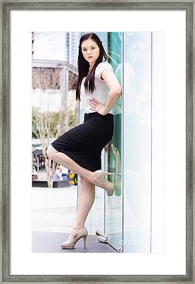Business Woman Opening A Door Of Opportunity Framed Print by Jorgo Photography - Wall Art Gallery
